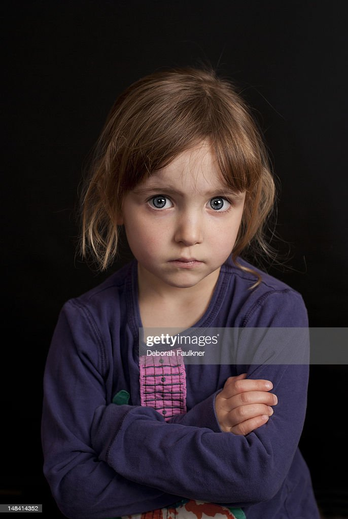 Small girl looking stern : Stock Photo