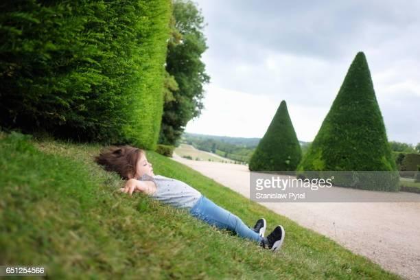 Small girl lying on grass