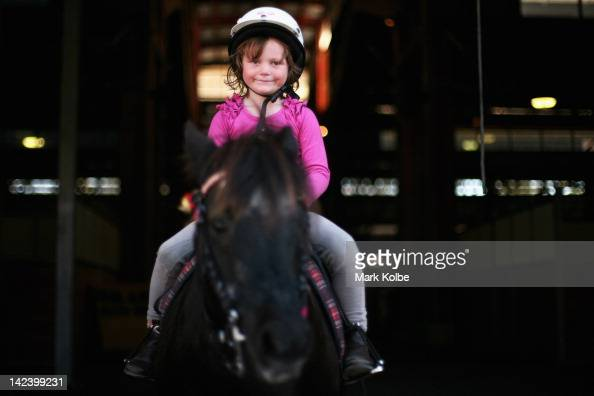 A small girl rides a pony during preparation for 2012 Sydney Royal Easter Show at the Sydney Showground on April 4 2012 in Sydney Australia The...