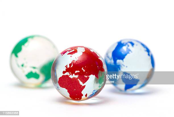 Small glass marbles with globe design on white for clarity