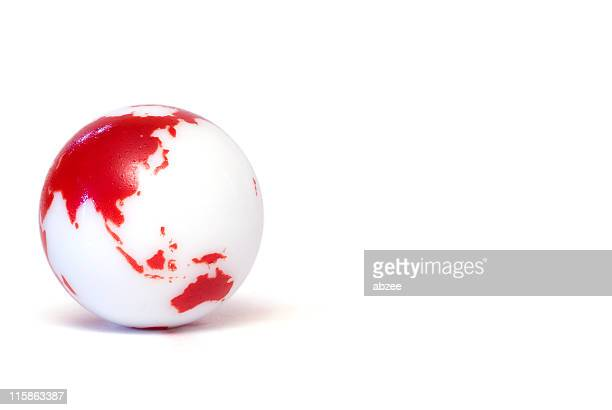 Small glass marbles with globe design on white