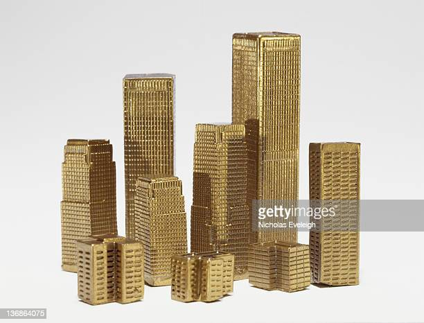 Small gold painted buildings