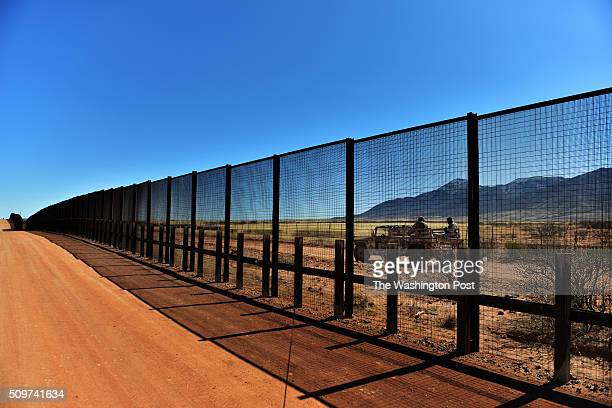 A small group from the Mexican Army can be seen through the fence that stands on the United States/Mexico border on Thursday February 28 in Naco AZ