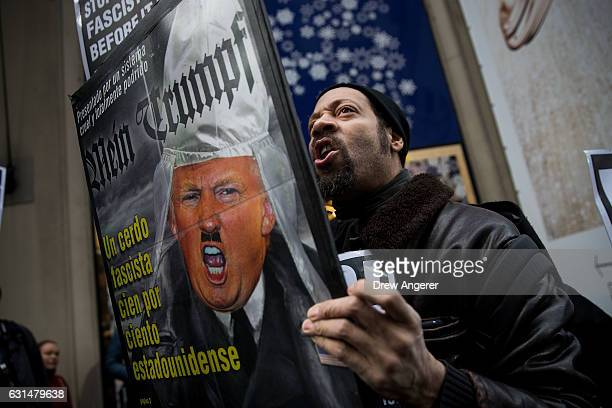 A small group of antiDonald Trump protestors rally across the street from Trump Tower January 11 2017 in New York City On Wednesday morning Trump is...