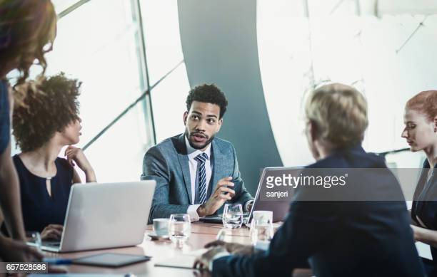 Small Group of Business People Having Meeting in the Board Room