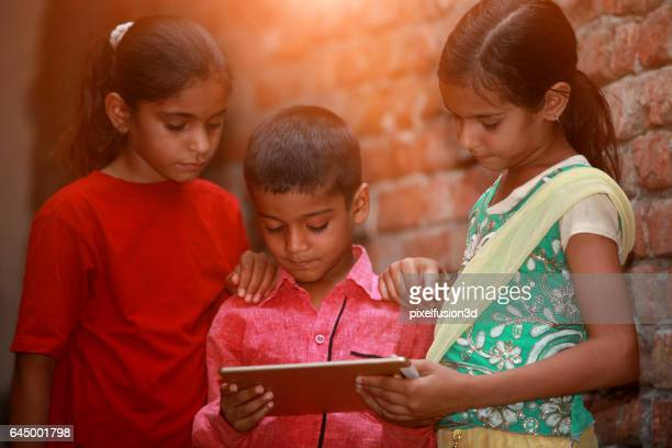Small group of children using digital tablet