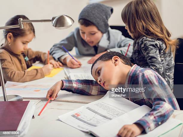 Small group of creative children studying.