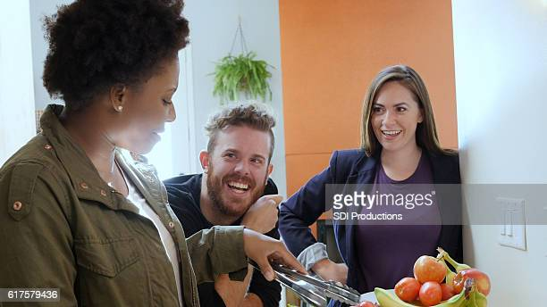 Small group of diverse friends prepare dinner together