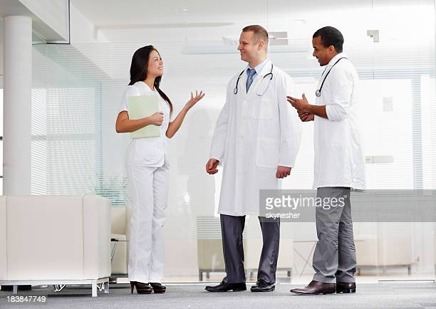 Small group of medical people discussing at the workplace.