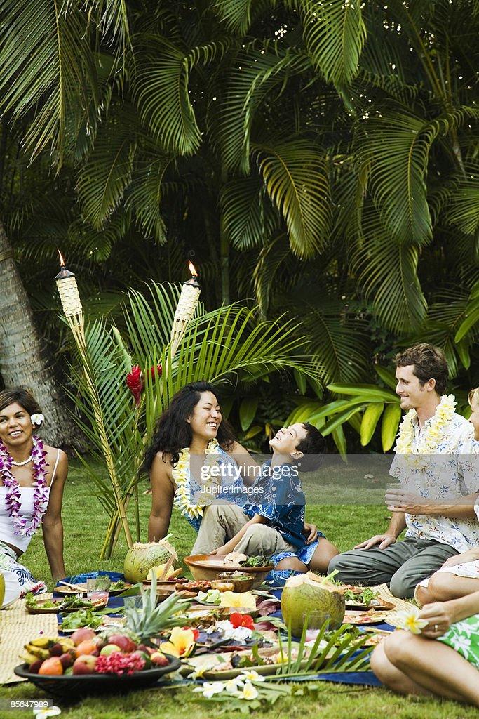 Small group of people at Hawaiian picnic : Stock Photo