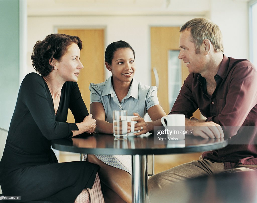 Small Group of People Chatting on Their Coffee Break : Stock Photo