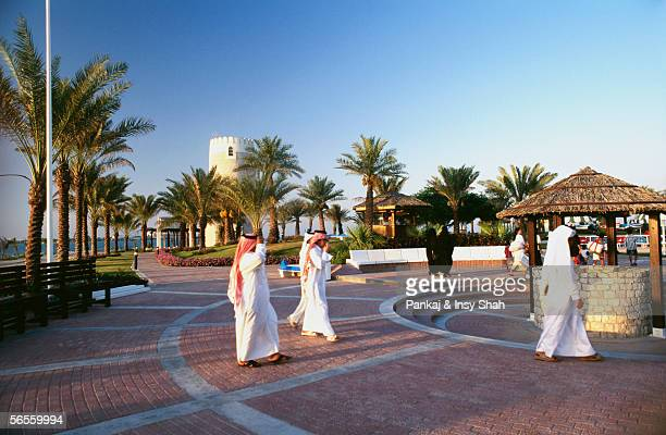 Small group of people enjoying the peaceful environment at a place surrounded with palm trees.