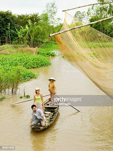 Small group of people on boat, Vietnam