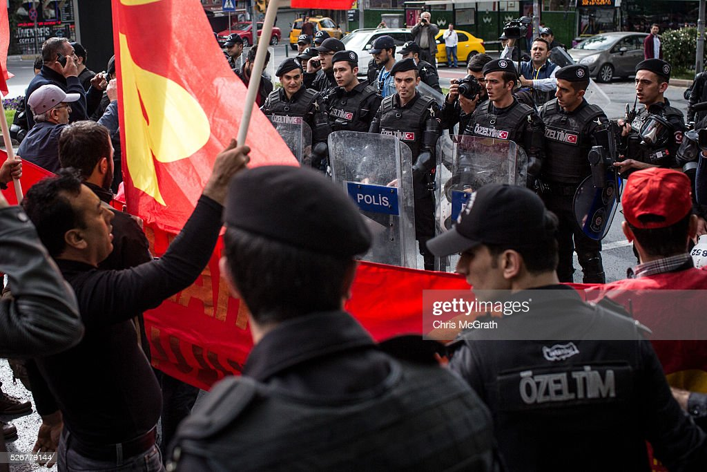 A small group of protesters clash with police on a street in the Besiktas neighbourhood during a May Day demonstration on May 1, 2016 in Istanbul, Turkey. Turkish police used tear gas and water cannon to disperse protesters as they tried to make their way to Taksim Square and other protest points.