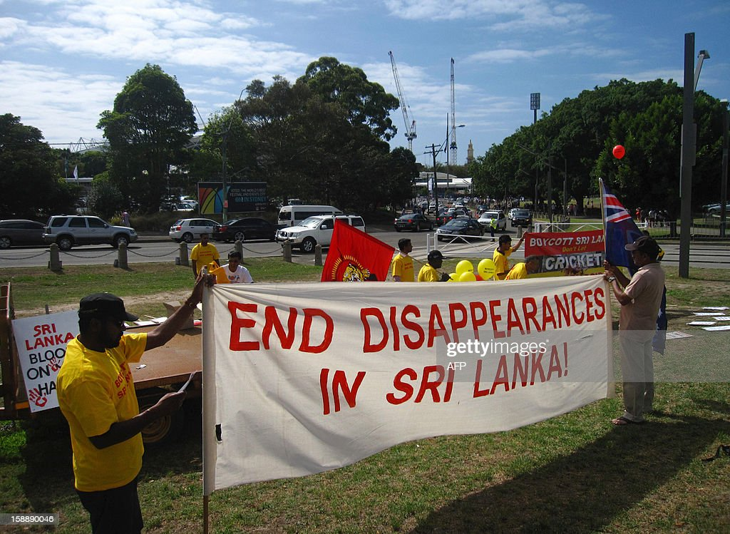 A small group of protesters display banners calling on Cricket Australia to boycott the Sri Lankan team, outside the Sydney Cricket Ground on January 3, 2013. Ethnic Tamils protested outside the Sydney Cricket Ground on January 3 demanding Australia boycott Sri Lankan cricket over Colombo's human rights abuses during the civil war.
