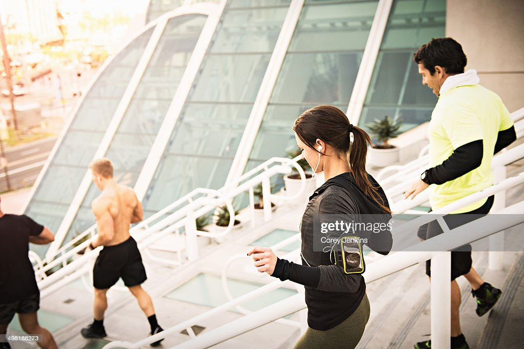 Small group of runners training on convention center steps