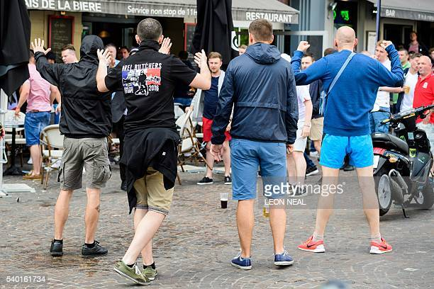 A small group of Russian men provoke a group of England supporters in the centre of Lille on June 14 three days after Russia and England football...