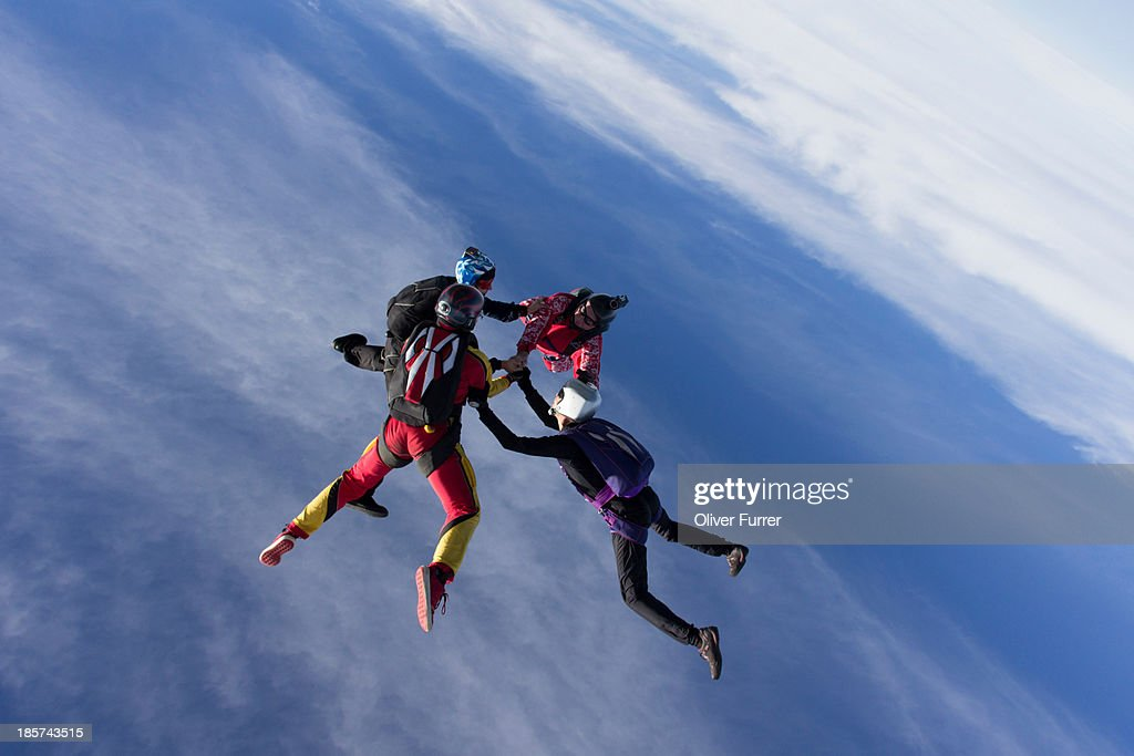 Small group of skydivers in formation