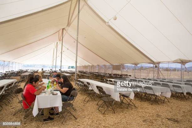A small group of tourists eat lunch in a giant tent meant to accommodate hundreds on August 20 2017 in Victor Idaho The small town located directly...