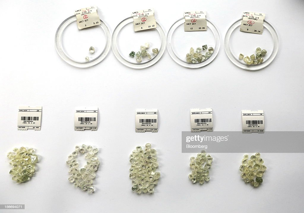 Small groups of uncut diamonds, sorted into different grades and labeled, are seen on a sorting table at the De Beers office in London, U.K., on Friday, Nov. 16, 2012. De Beers, the biggest diamond producer by revenue, is moving the sorting and trading of rough stones to Botswana from London to secure access to the world's largest supplier of diamonds by value and challenge Antwerp's dominance as the world's biggest trading hub for rough diamonds. Photographer: Chris Ratcliffe/Bloomberg via Getty Images