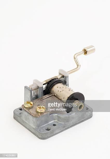 Small hand crank musical box