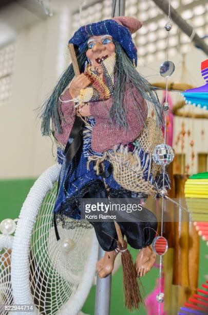 Small handmade toy witch hanging on clothesline