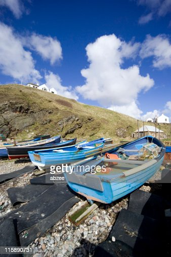 Small harbour with boats on beach