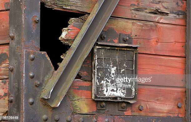 A small hole in the wooden structure of what is believed to be a German boxcar used during the Holocaust is seen during its unveiling November 9 2005...