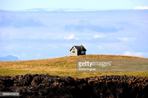Small house on a small Island : Stock Photo