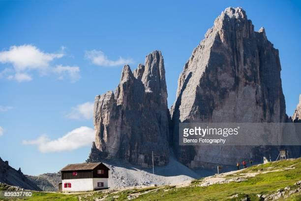 Small house with group of trekker in Tre cime, Dolomite, Italy