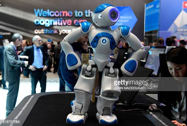 A small interactive robot from IBM's Watson AI department shows fairgoers some moves at the Digital Business fair CEBIT in Hanover central Germany on...