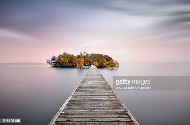 Small Island connected with wooden jetty