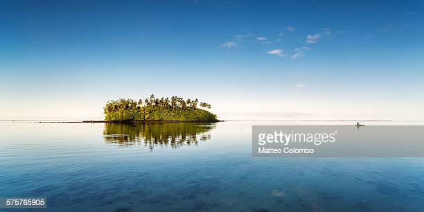 Small island with man kayaking, Cook Islands