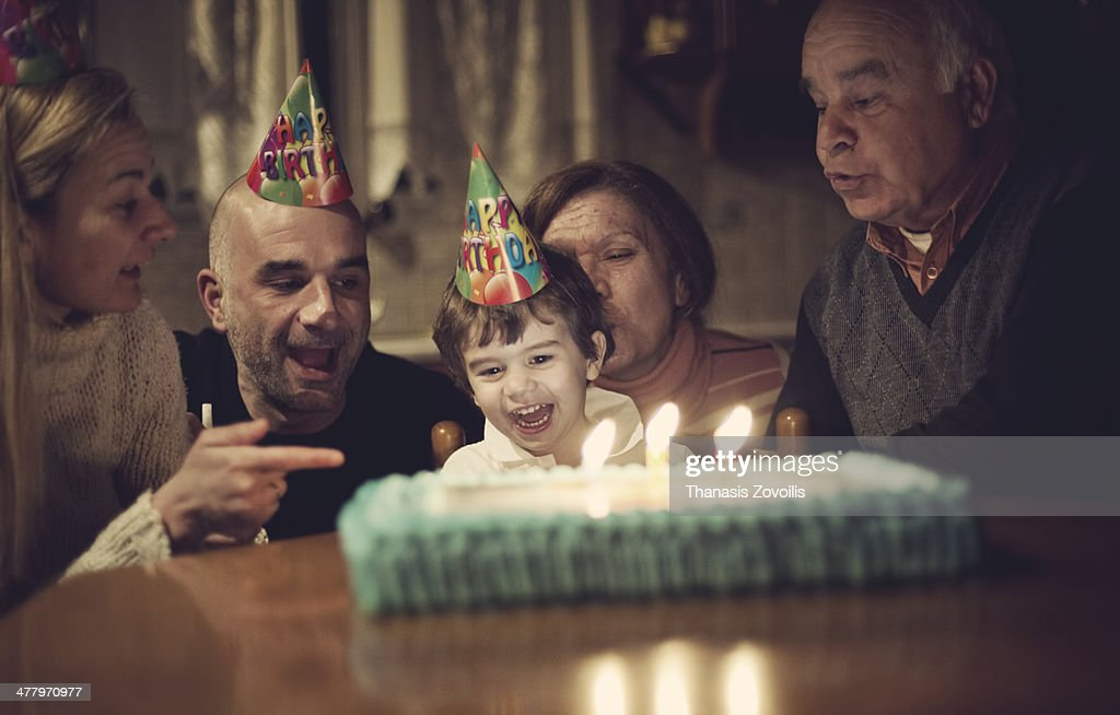Small kid celebrating with his family his birthday