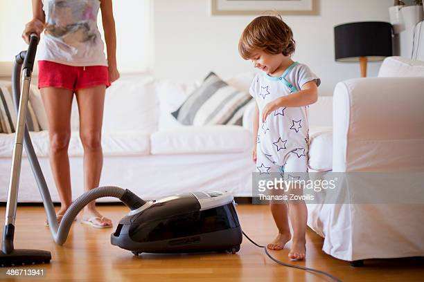 Small kid playing with his mother
