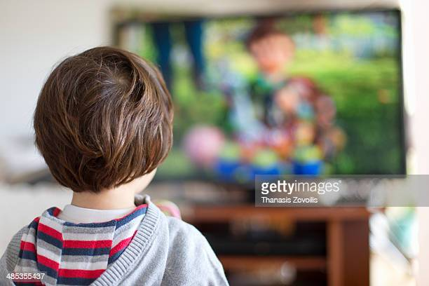 Small kid watching television