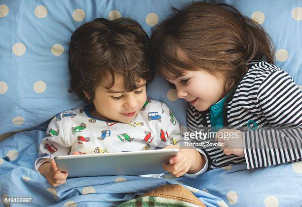 Small kids using a digital tablet