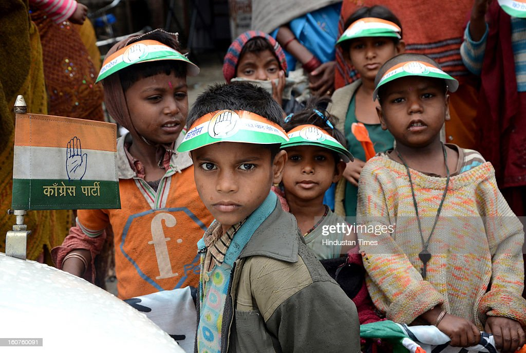 Small kids & women waiting for Rahul Gandhi outside Fursatganj Airport, on February 5, 2013 in Amethi, India. Rahul's visit to his parliamentary constituency of Amethi for the first time as Congress vice president has been postponed due to inclement weather.
