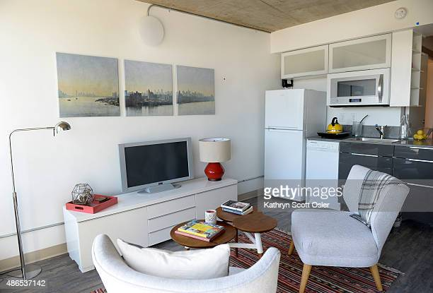 A small kitchen uses a compact refrigerator and dishwasher just off the living area of one of the 345 square foot apartments Johnson Nathan Strohe...