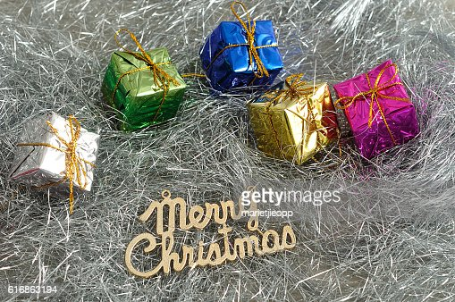Small little gifts wrap in Shiny paper : Stock Photo