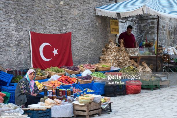 Small market at Safranbolu town, fruits and vegetables and a big turkish gflak hung on the wall, Karabuk, Turkey