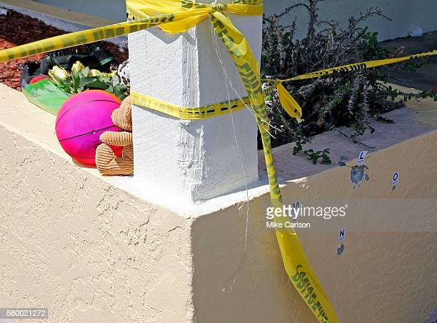 A small memorial begins near where bullet holes are marked outside of Club Blu where two people were killed and at least 15 wounded on July 25 2016...
