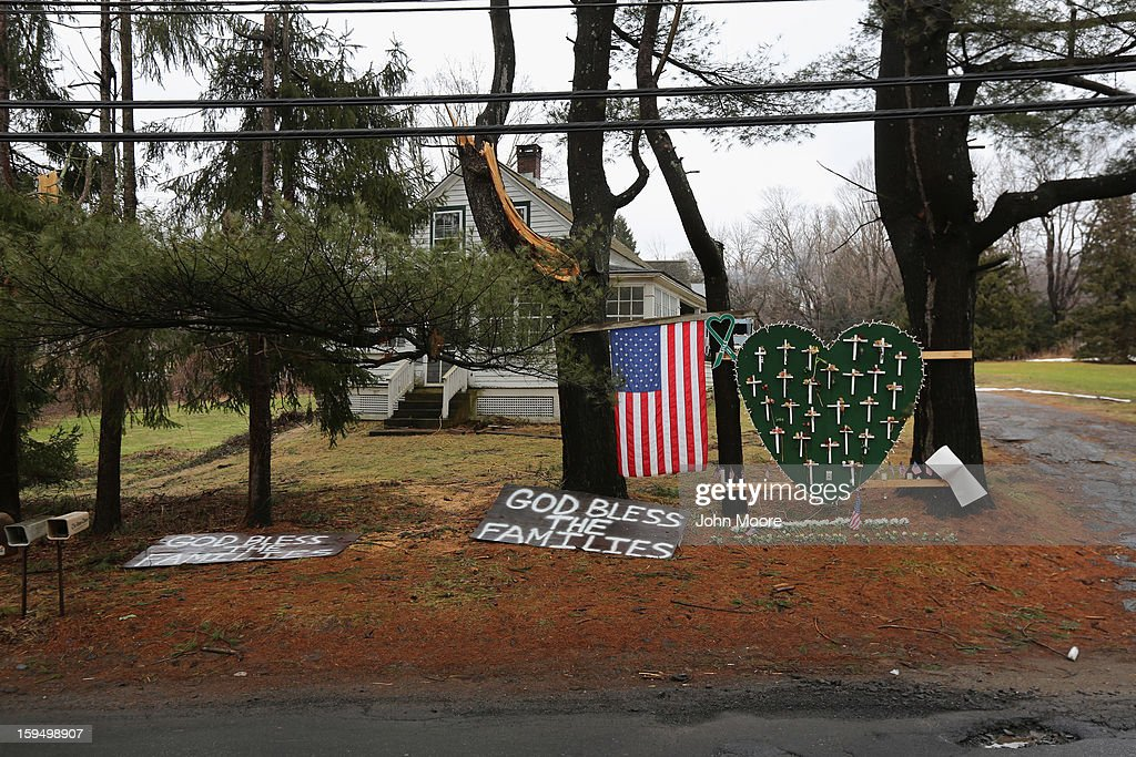 A small memorial lines a road near Sandy Hook Elementary School on January 14, 2013 in Newtown, Connecticut. The town marked a month anniversay since the massacre of 26 children and adults at the school, the second-worst such shooting in U.S. history.