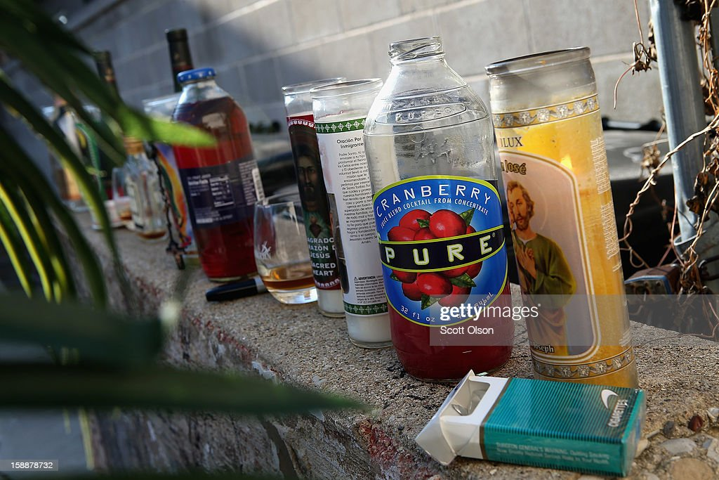 A small memorial marks the spot in an alley where 20-year-old Octavius Dontrell Lamb was shot yesterday and killed, on January 2, 2013 in Chicago, Illinois. At 3:45 a.m., less than four hours into the new year, Lamb became the first murder victim of 2013 in Chicago, a city which saw more that 500 murders in 2012. Fifteen people were shot in Chicago on the first day of the year, three fatally. Aurora, Illinois' second largest city, had no murders in 2012.