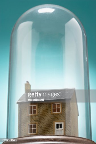 Small model house under glass cover