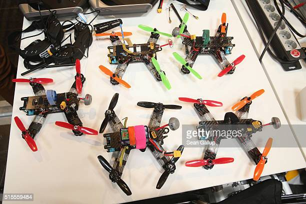 Small multirotor racing drones lie on a table in the Dronemasters hall at the 2016 CeBIT digital technology trade fair on the fair's opening day on...