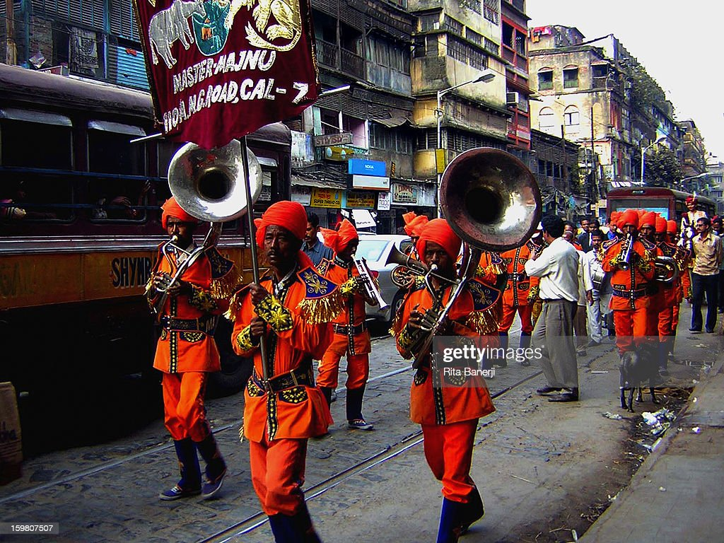 CONTENT] Small musical bands pave the way through the busy traffic, to announce the arrival of the groom and his relatives at weddings in India. The groom is on a horse towards the end of the procession.