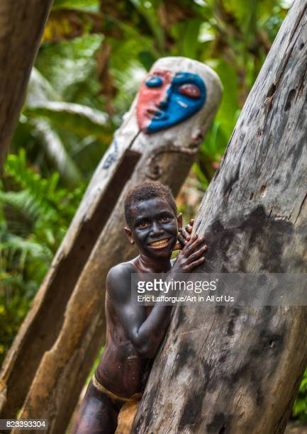 Small Nambas tribe boy in front of a giant slit gong drum during a ceremony Malekula island Gortiengser Vanuatu on August 25 2007 in Gortiengser...