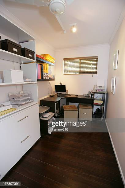 Small office with corner desk and white decor