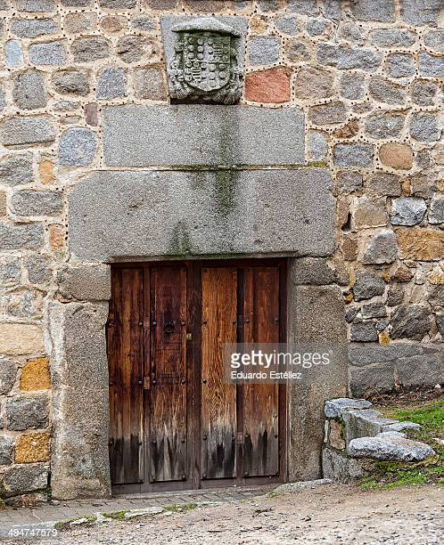 Small old door with shield